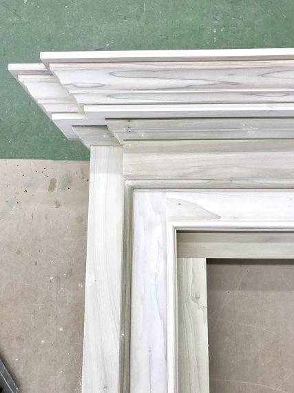 profile of a custom mantel under construction