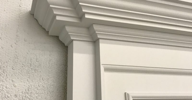 corner of a white read to order wainscoting fireplace - /wainscoting-name-and-other-questions/